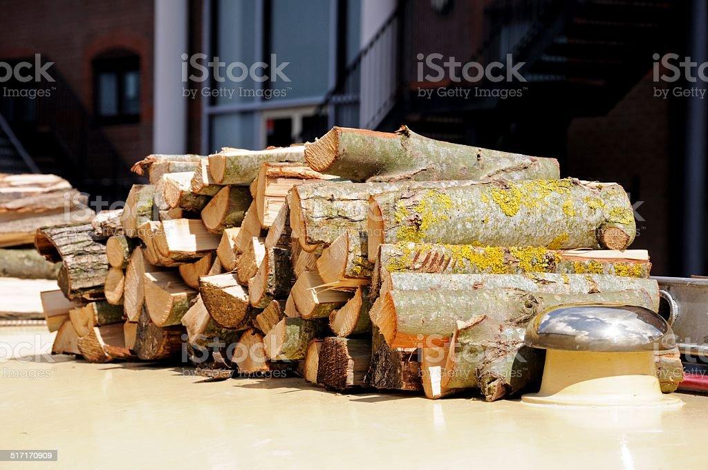 Chopped logs on narrowboat roof. stock photo