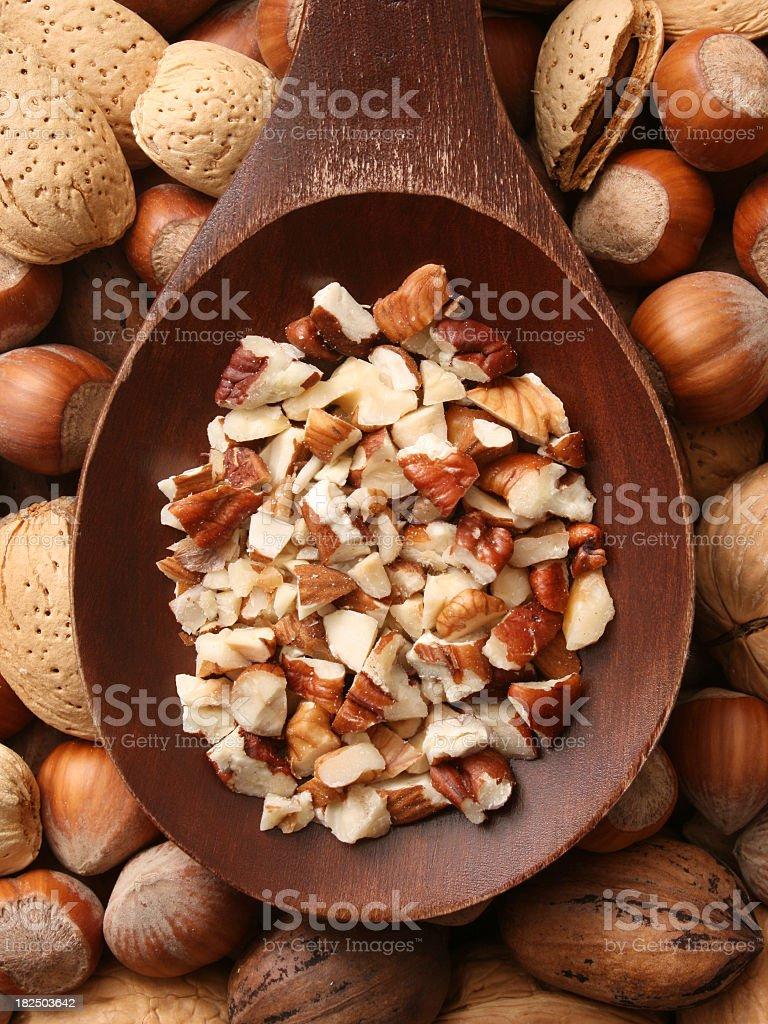Chopped mixed nuts stock photo