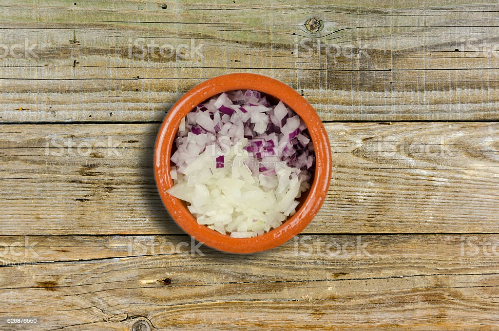 chopped onion in a small clay bowls stock photo