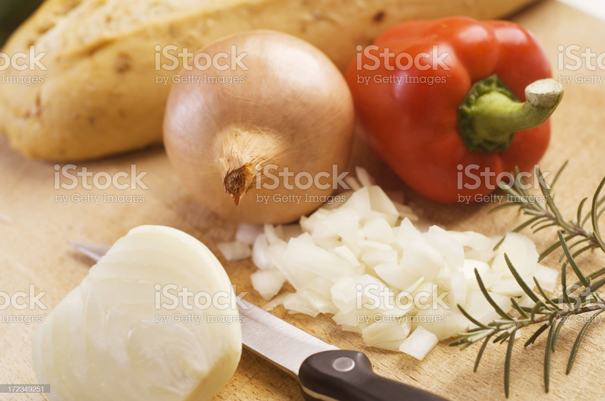 Chopped onions with capsicum and rosemary royalty-free stock photo