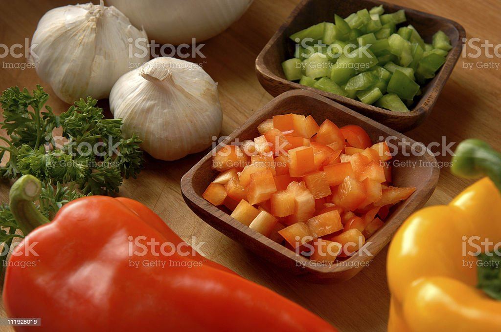 Chopped Peppers Whole Garlic Parsley on Cutting Board royalty-free stock photo