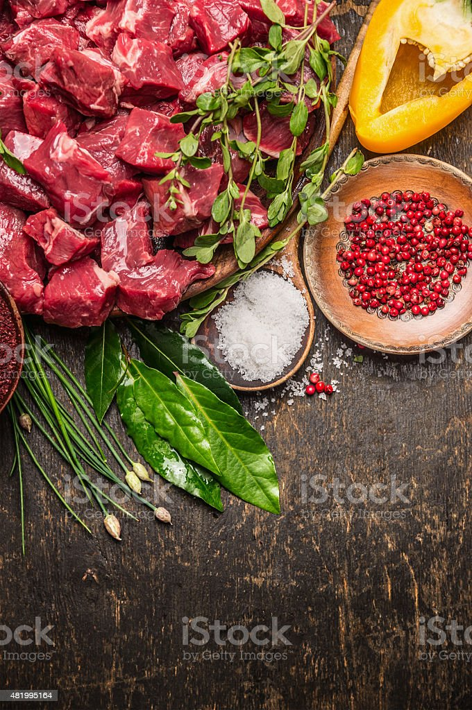 Chopped raw meat with vegetables, herb and spices for goulash stock photo