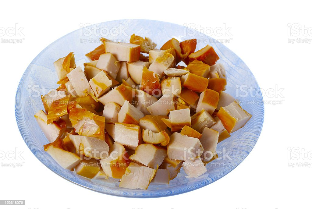 chopped smoked chicken meat in the plate isolated stock photo