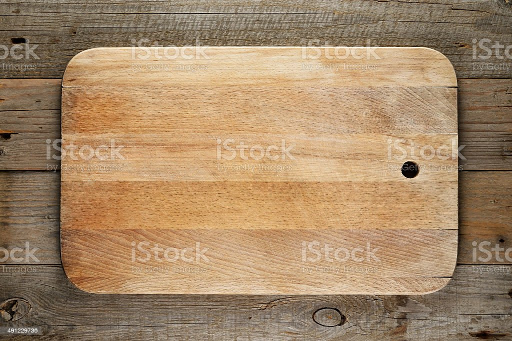Chopping board on wood stock photo