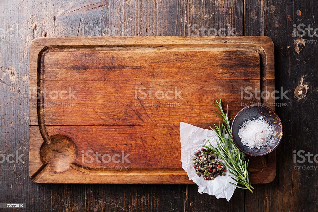 Chopping board, seasonings and rosemary stock photo