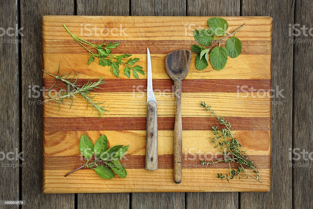 Chopping Board with Mixed Herbs stock photo