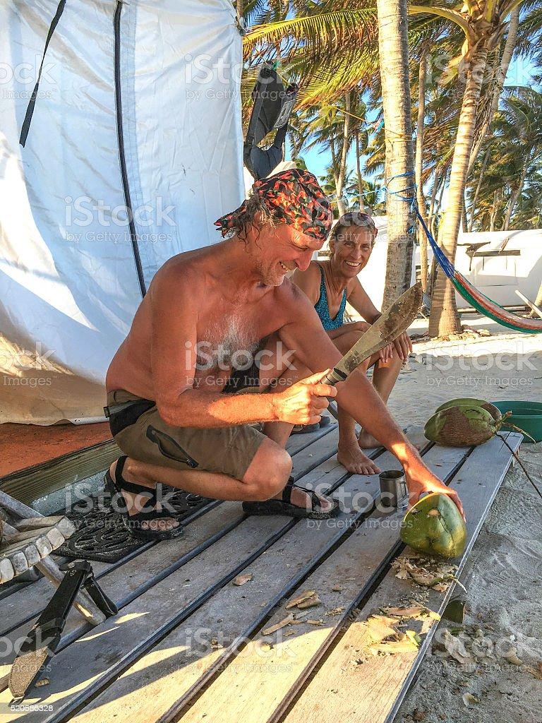 Chopping coconuts stock photo