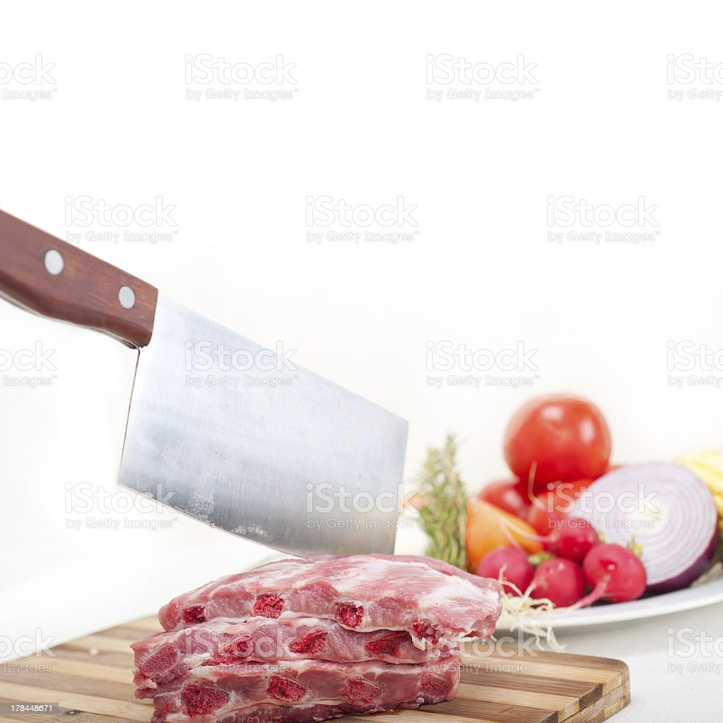 chopping fresh pork ribs and vegetables royalty-free stock photo