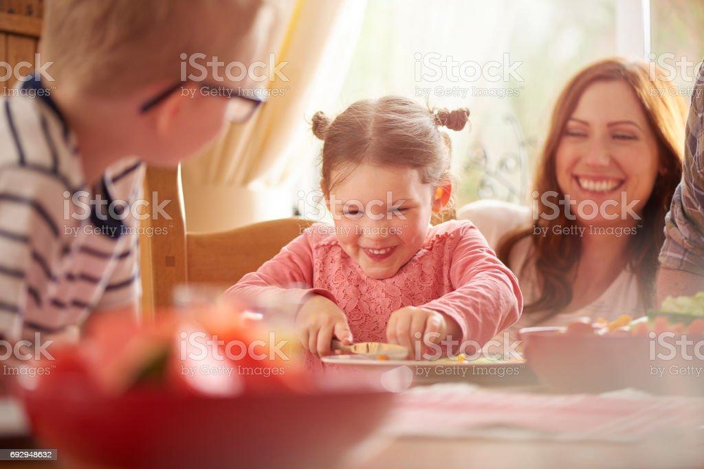 chopping her dinner stock photo