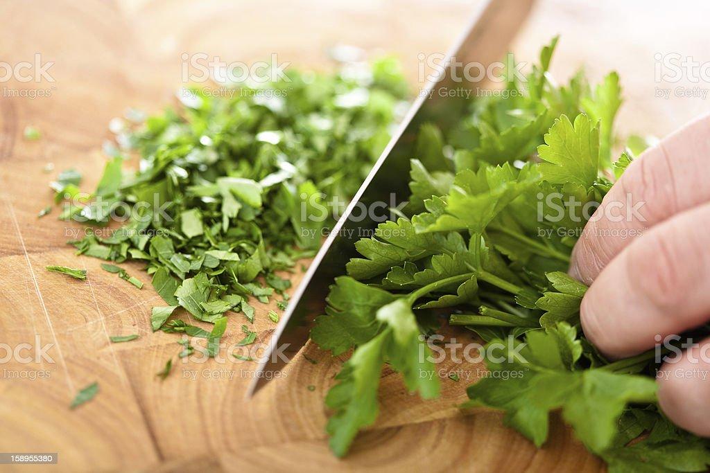 chopping parsley stock photo