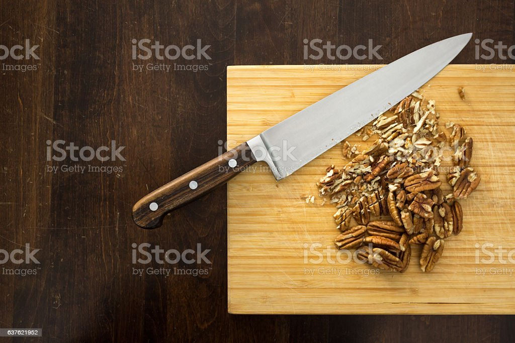 Chopping pecans, from above stock photo