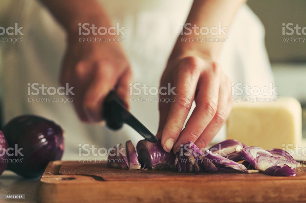 chopping red onions stock photo