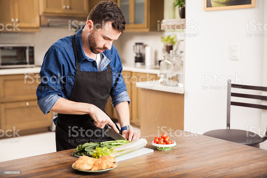 Chopping some vegetables at home stock photo