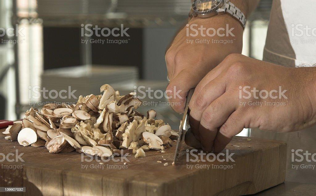 Chopping the mushrooms royalty-free stock photo