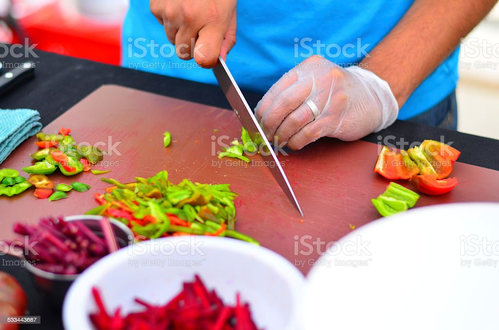 Chopping vegetables and peppers stock photo