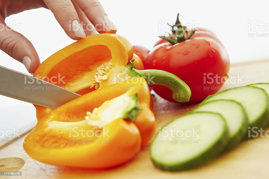 Chopping vegetables for a salad royalty-free stock photo