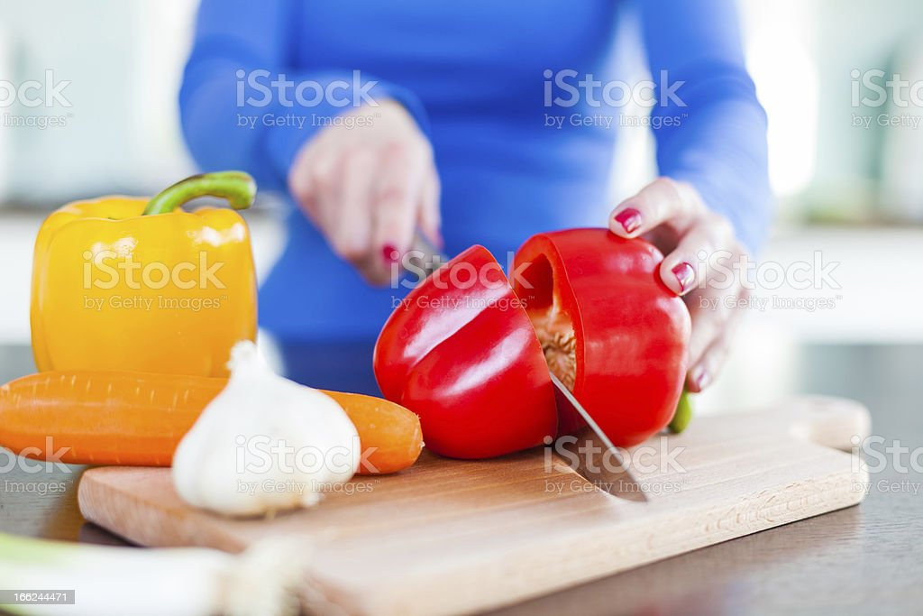Chopping Vegetables in the Kitchen royalty-free stock photo