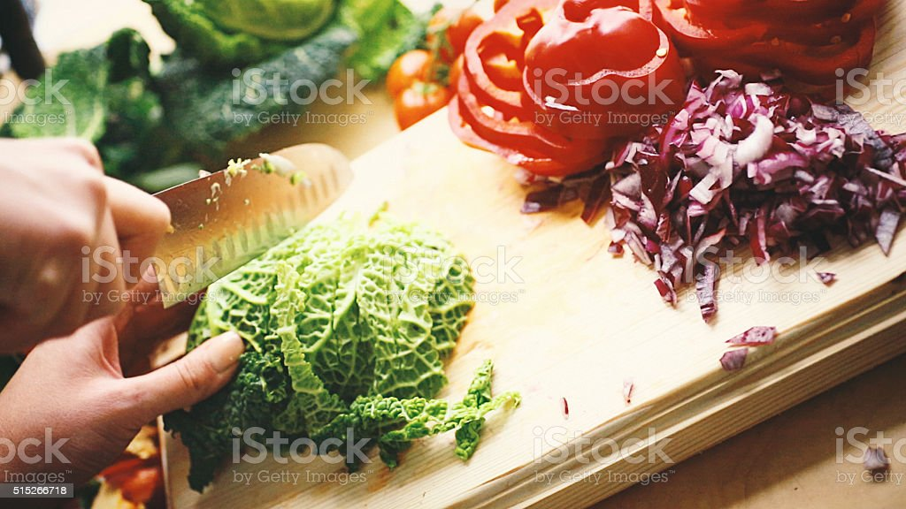 Chopping vegetables. stock photo