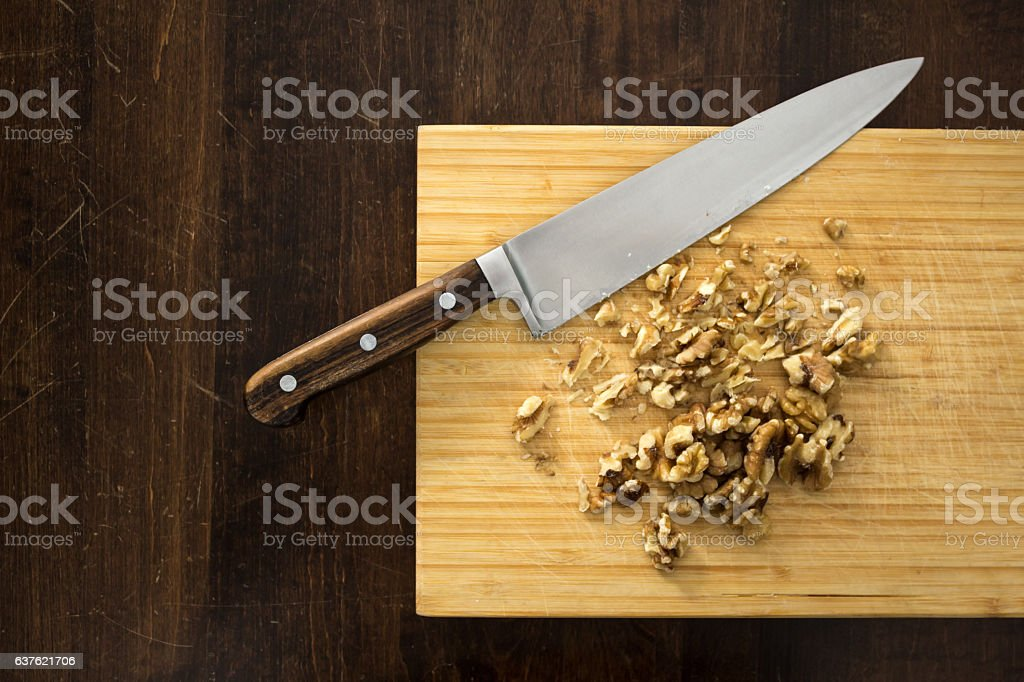 Chopping walnuts, from above stock photo