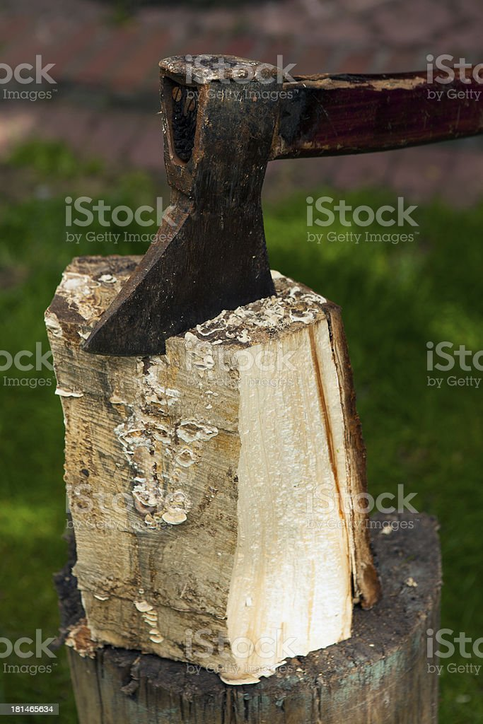 Chopping wood with an ax stock photo