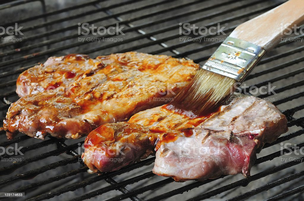 Chops getting sauced stock photo