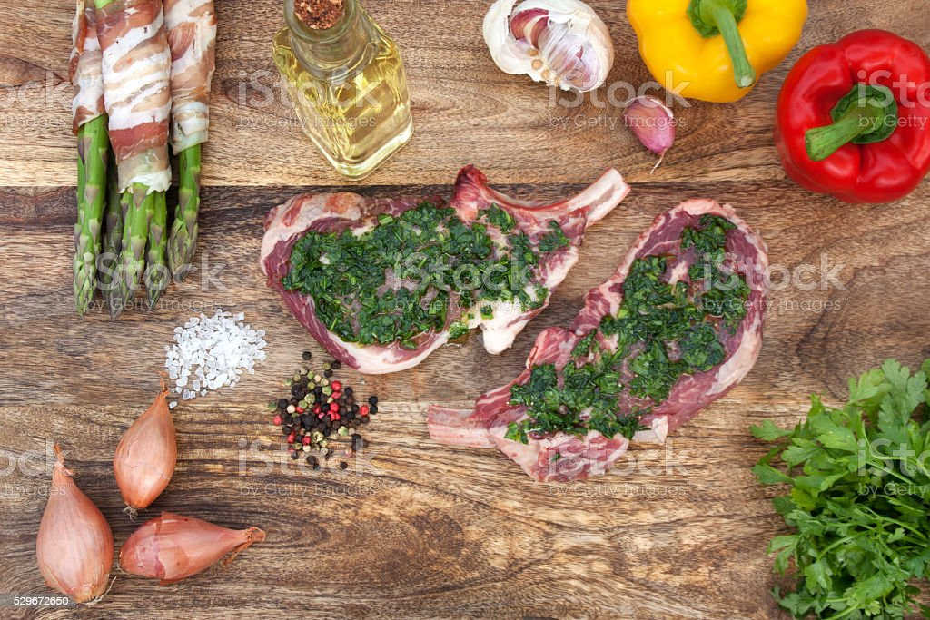 Chops in a herb marinade with ingredients stock photo