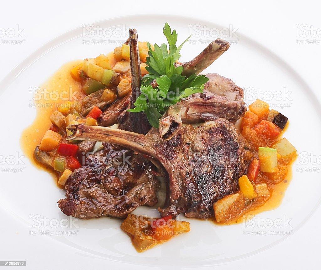 Chops on white dish. stock photo