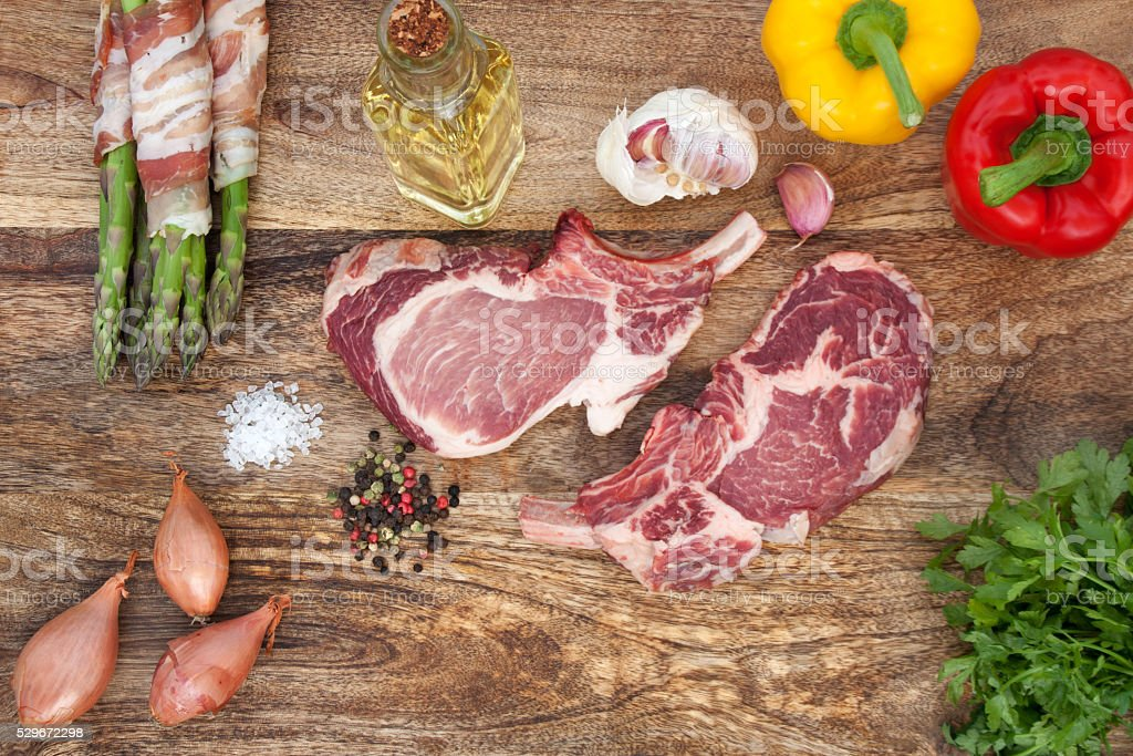 Chops raw with spices and vegetables stock photo