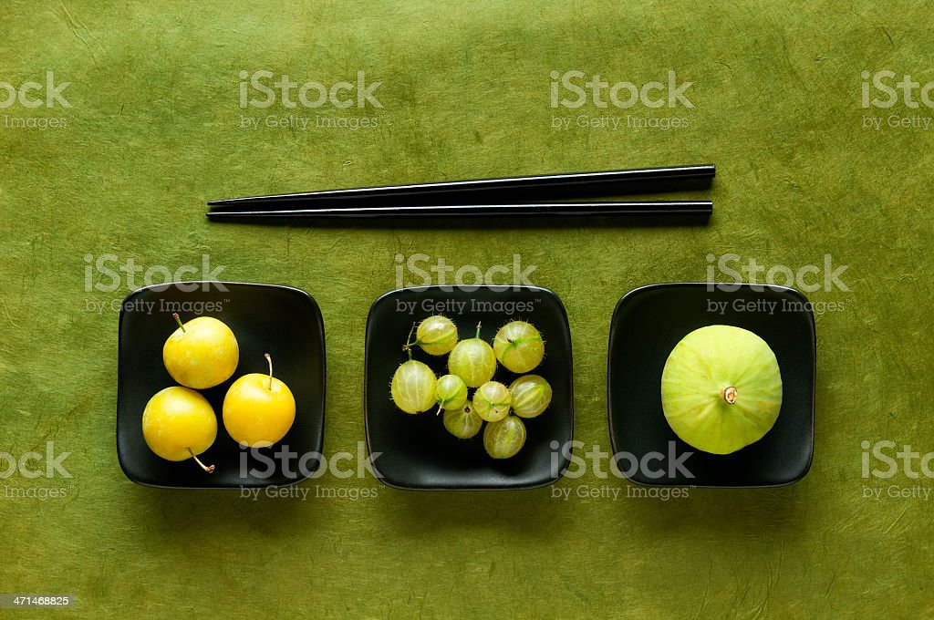 Chopstick Challenge – Asian Plums, Gooseberries & Fig royalty-free stock photo