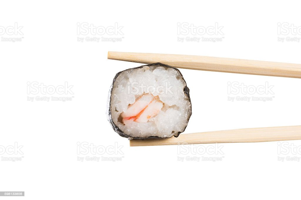 Chopstick with sushi roll closeup stock photo