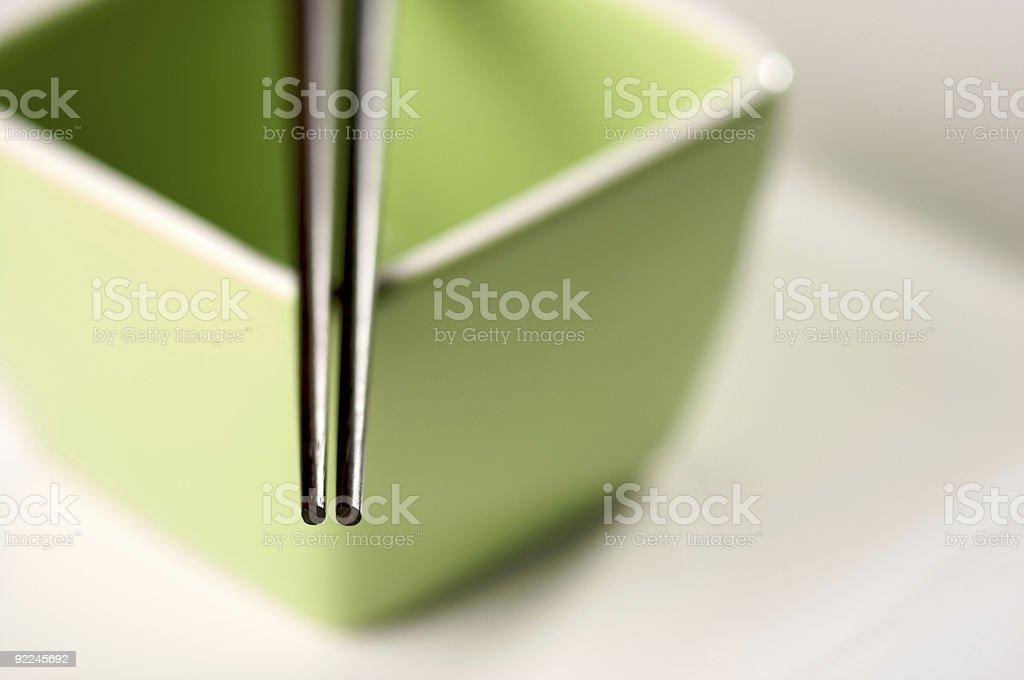 Chopsticks and Green Bowl royalty-free stock photo