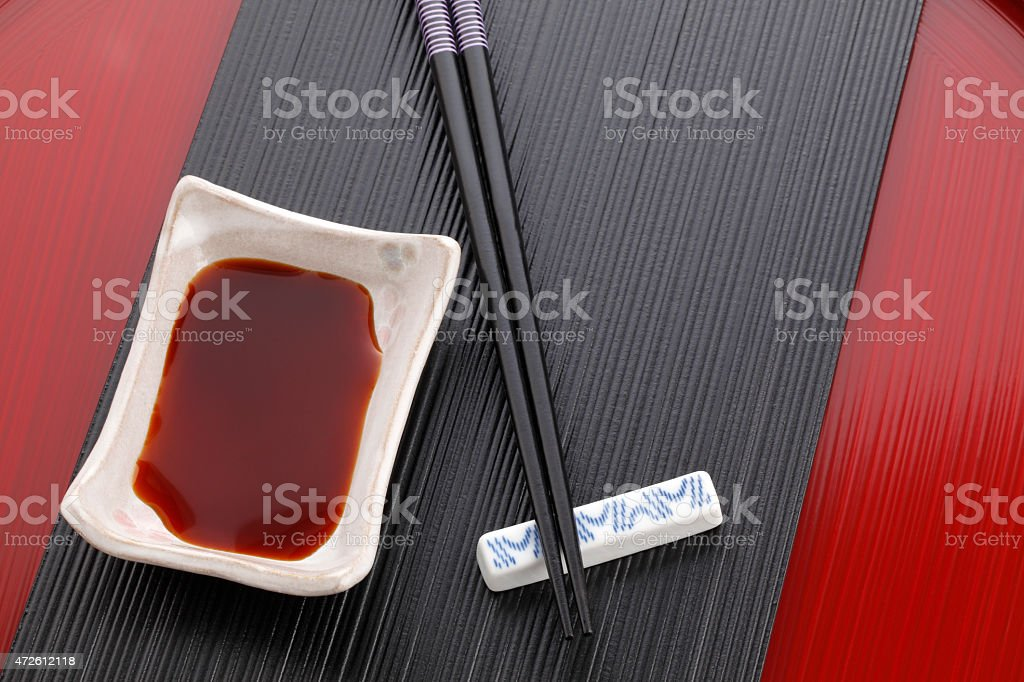 Chopsticks and soy sauce stock photo