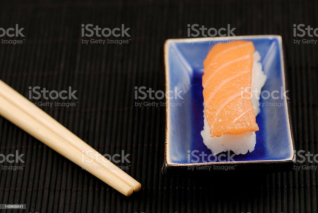 Chopsticks and sushi nigiri royalty-free stock photo