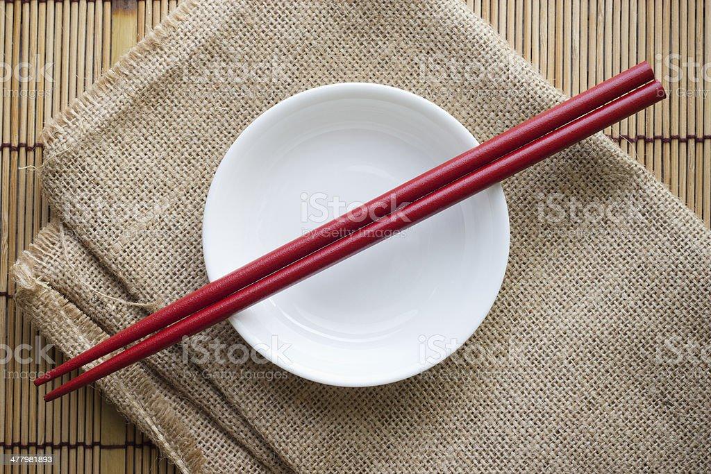 Chopsticks on a bowl royalty-free stock photo