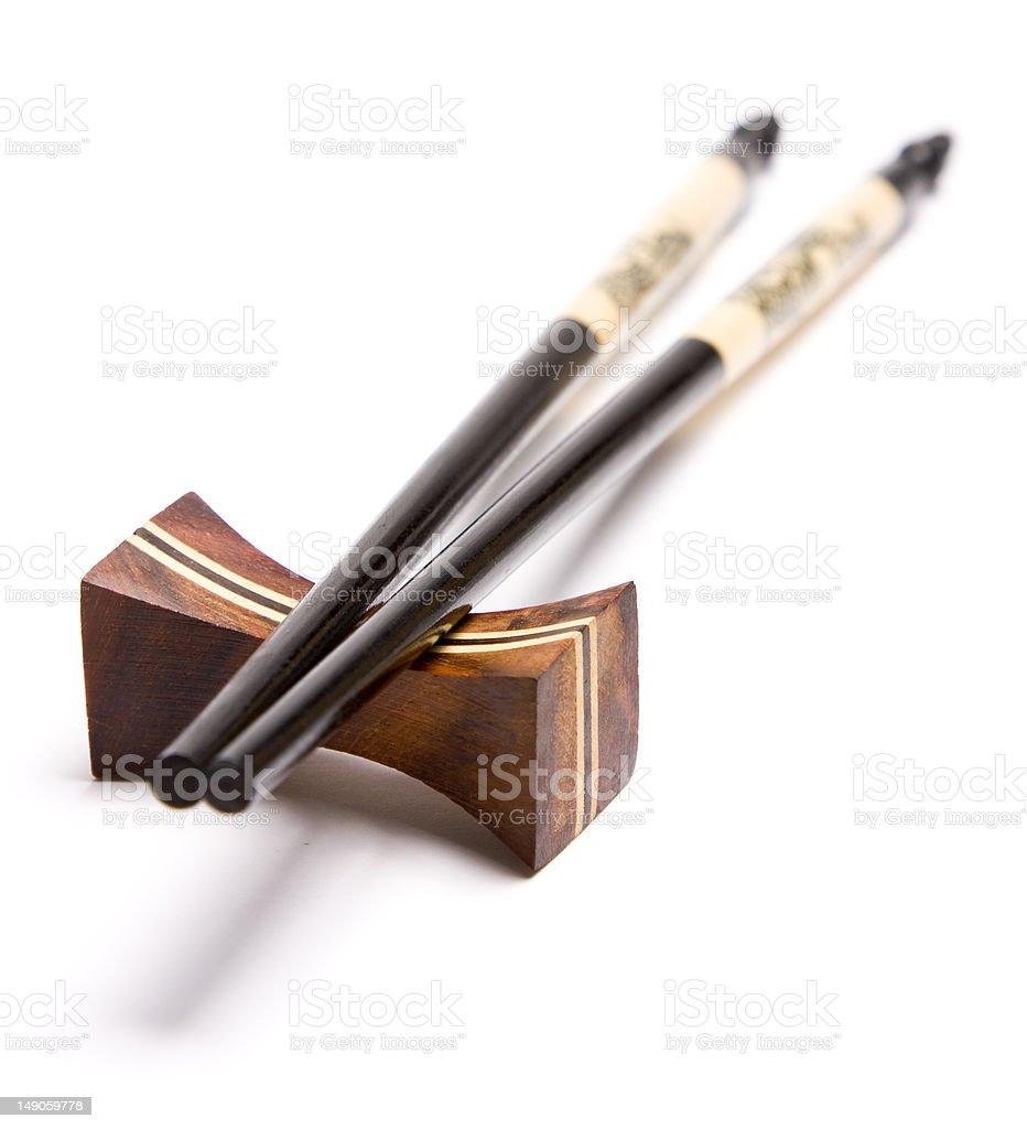 Chopsticks on a chopstick rest royalty-free stock photo