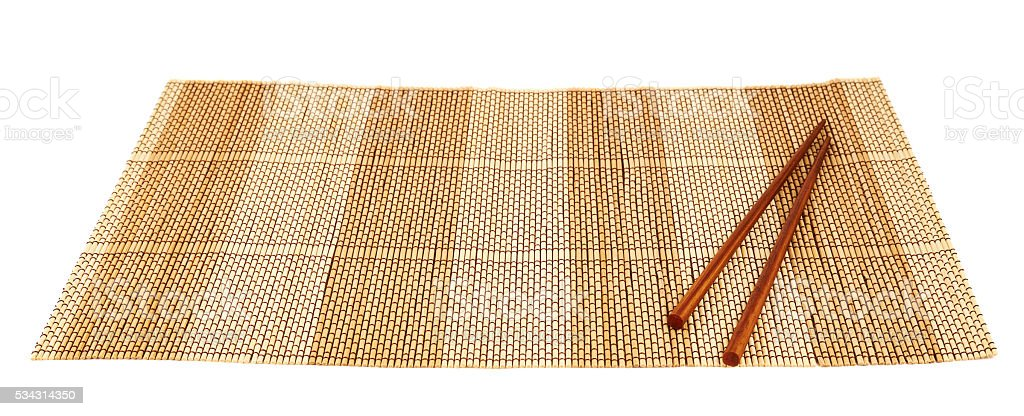 Chopsticks over a bamboo mat stock photo