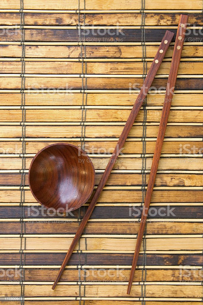 Chopsticks resting on bamboo background royalty-free stock photo