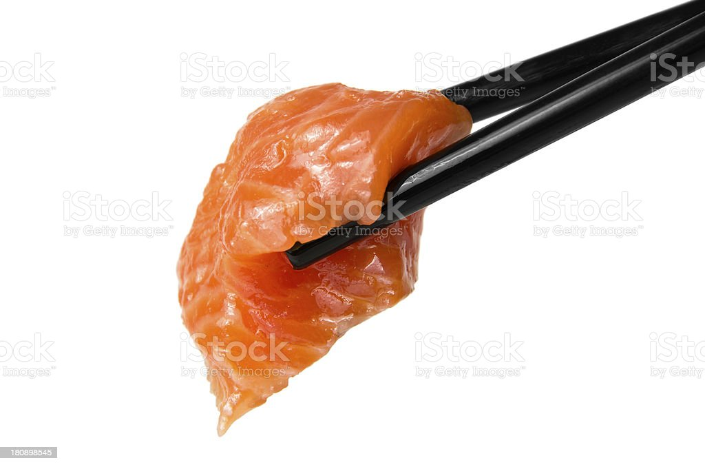 Chopsticks with sliced raw trout royalty-free stock photo