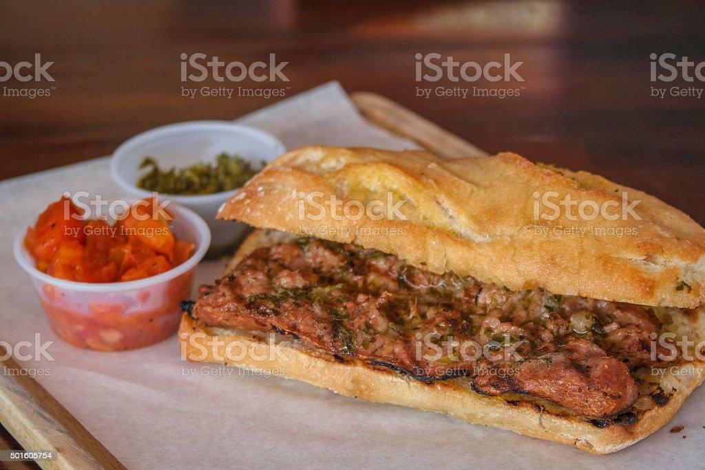 Choripan, chorizo hot dog with chimichurri sauce, Argentine food stock photo