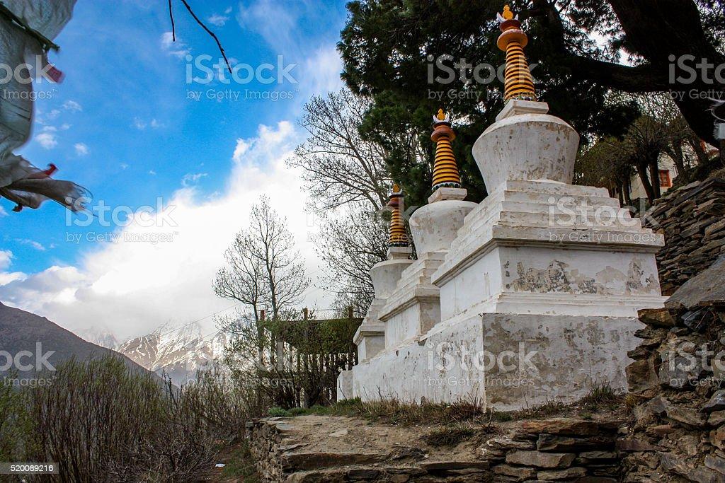 Chorten, white-domed bhuddhist stupa stock photo