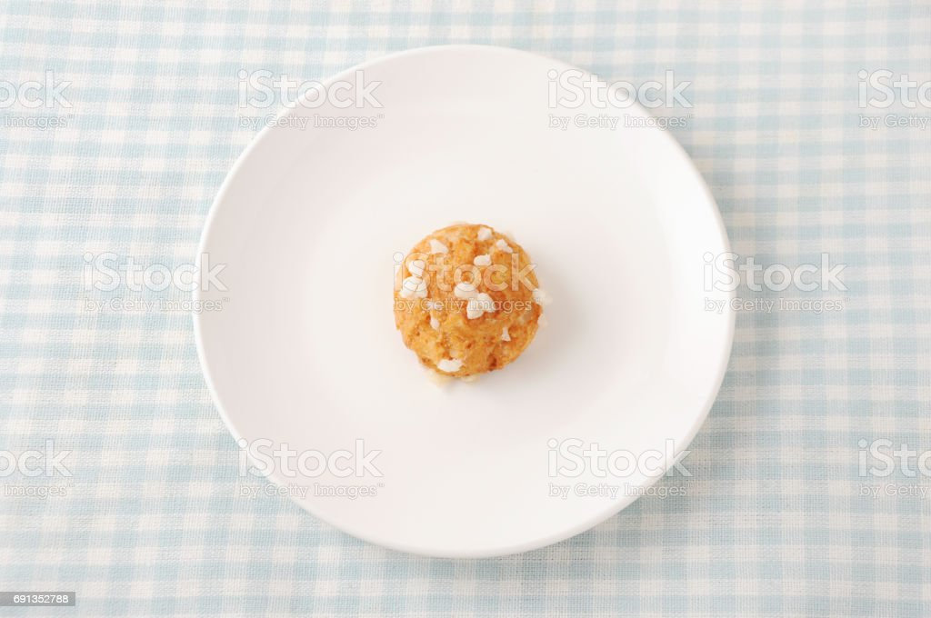 chouquette cream puffs on plate on white background stock photo
