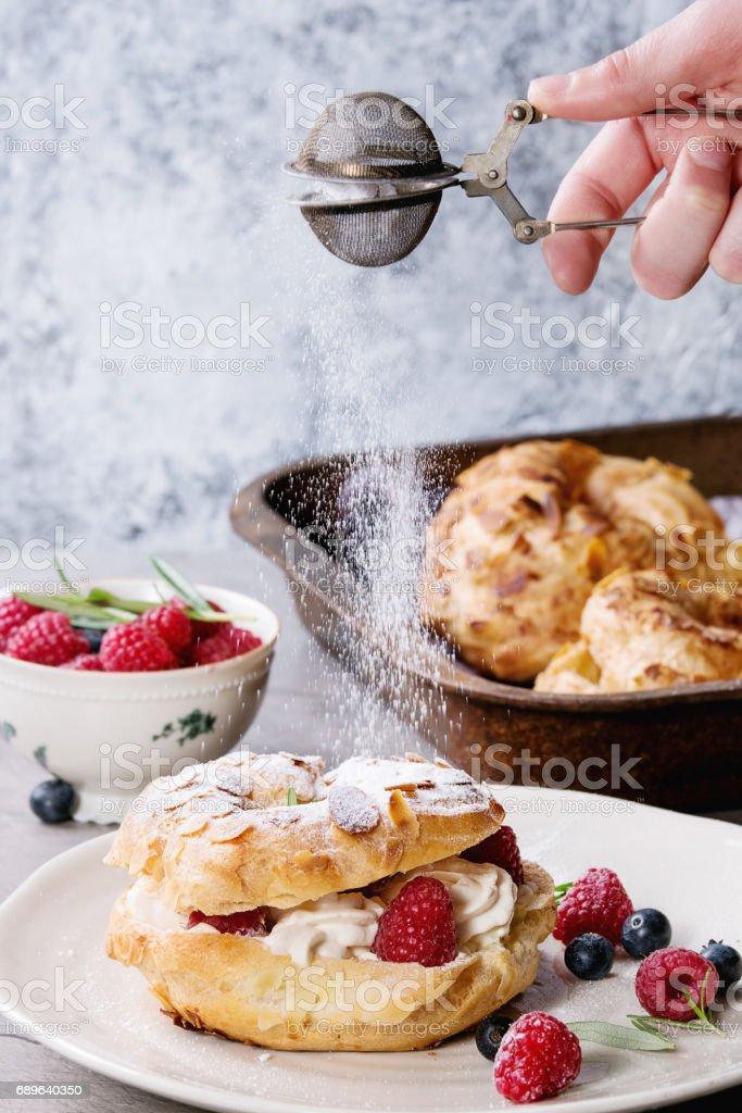 Choux cake Paris Brest with raspberries stock photo