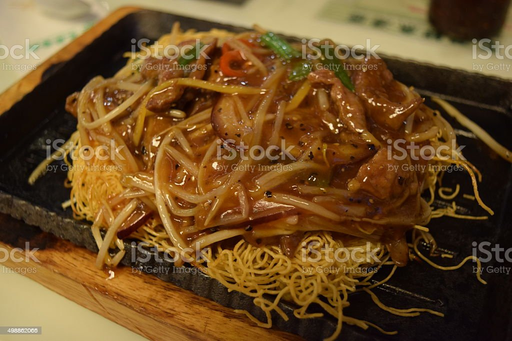 Chow mein on hot plate. stock photo