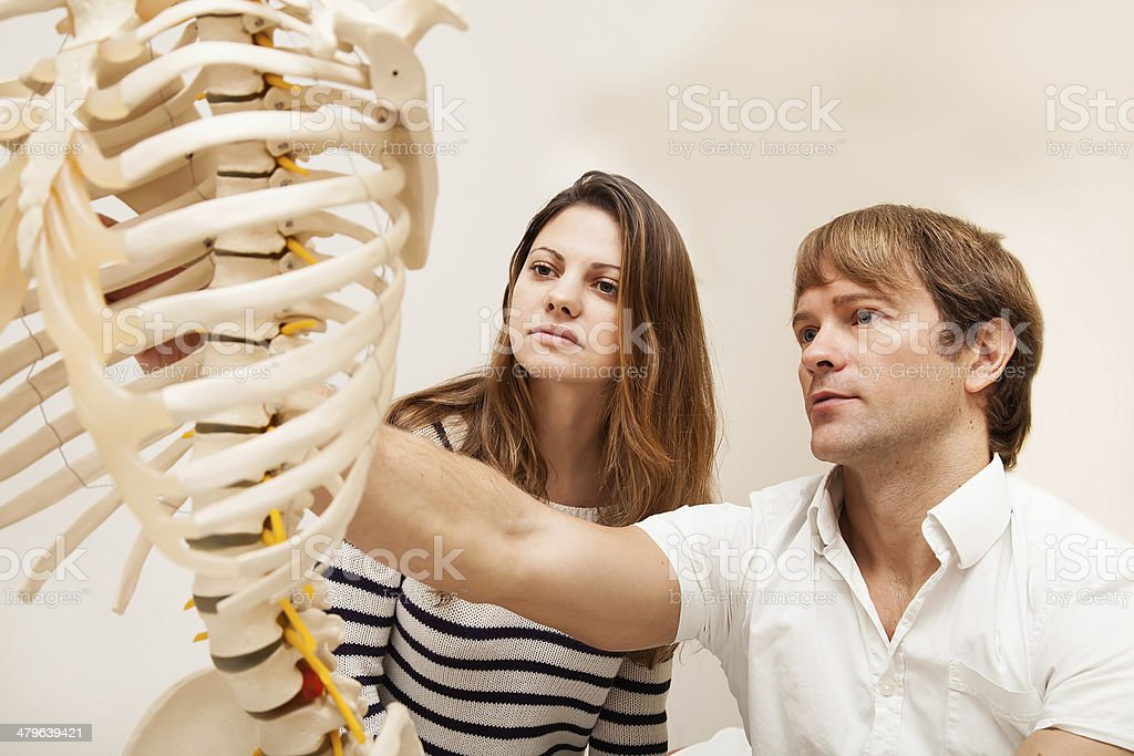 Chriopractor and patient stock photo