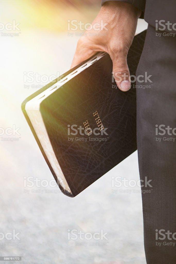 Chrisitian Bible in Hand stock photo