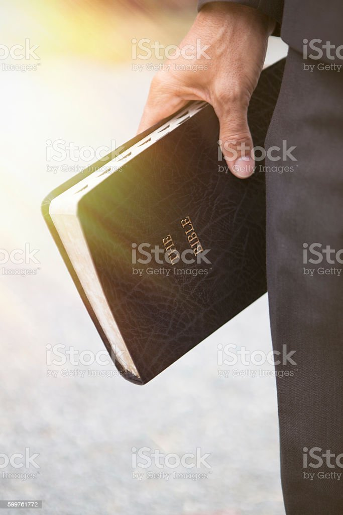 Chrisitian Bible in Hand stock photo