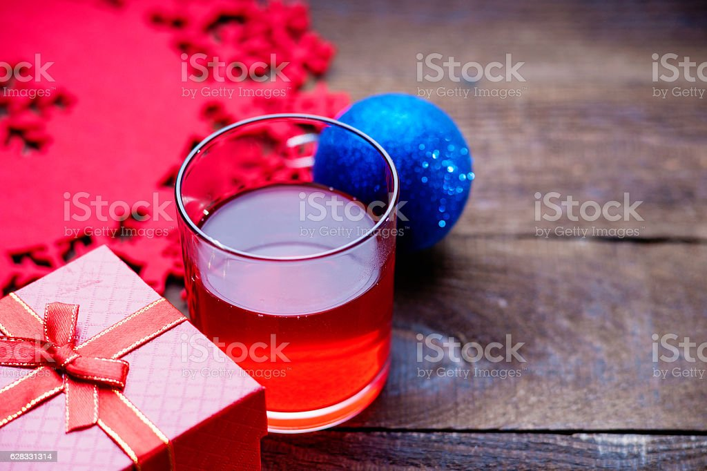 Chrismas ball, gift box, hot mulled wine and decorations stock photo