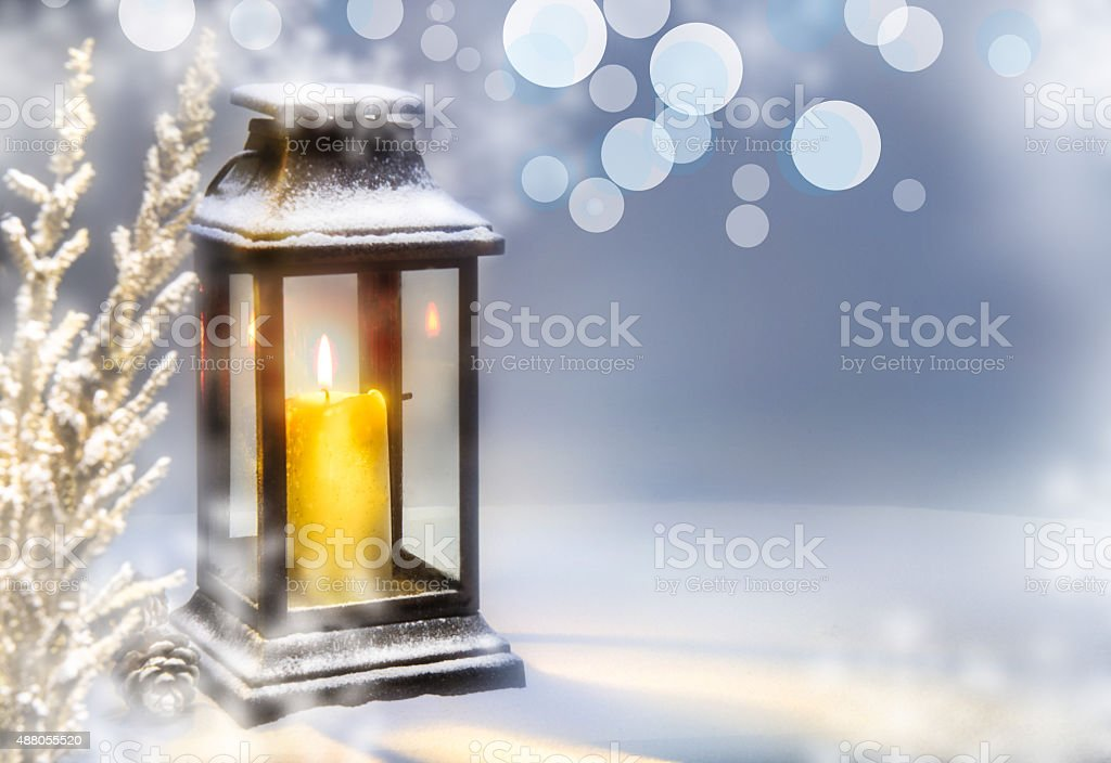 Chrismas lantern in snow stock photo