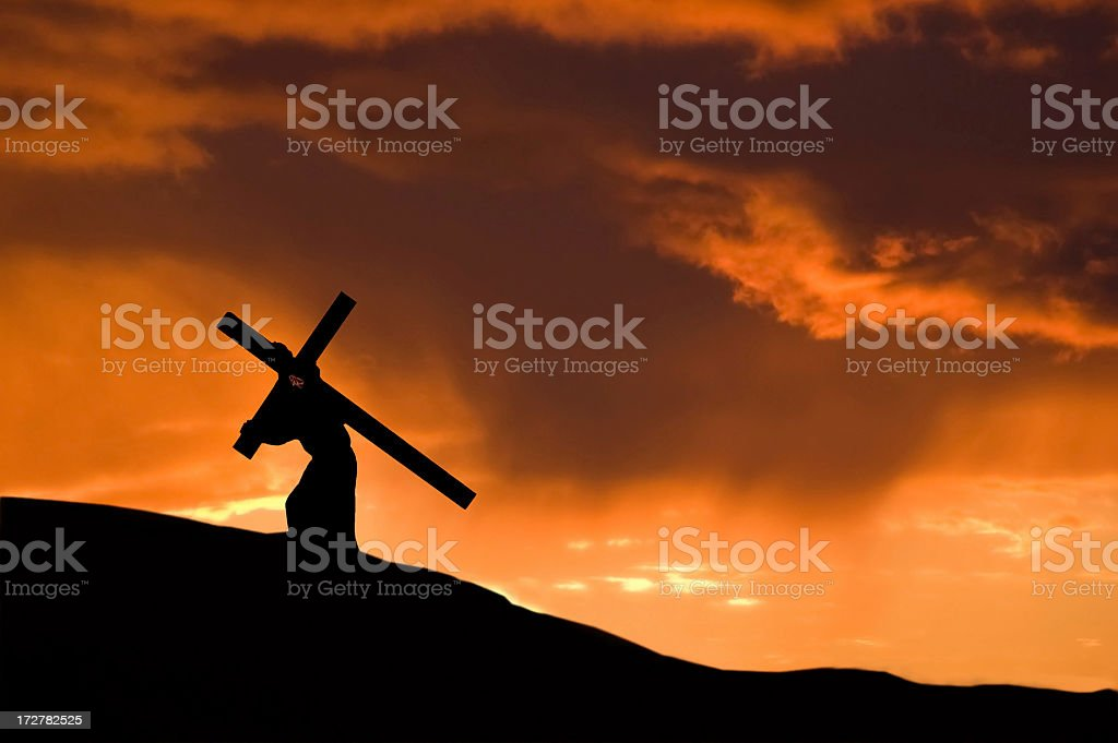 Christ Carrying the Cross With an Orange Sunset royalty-free stock photo