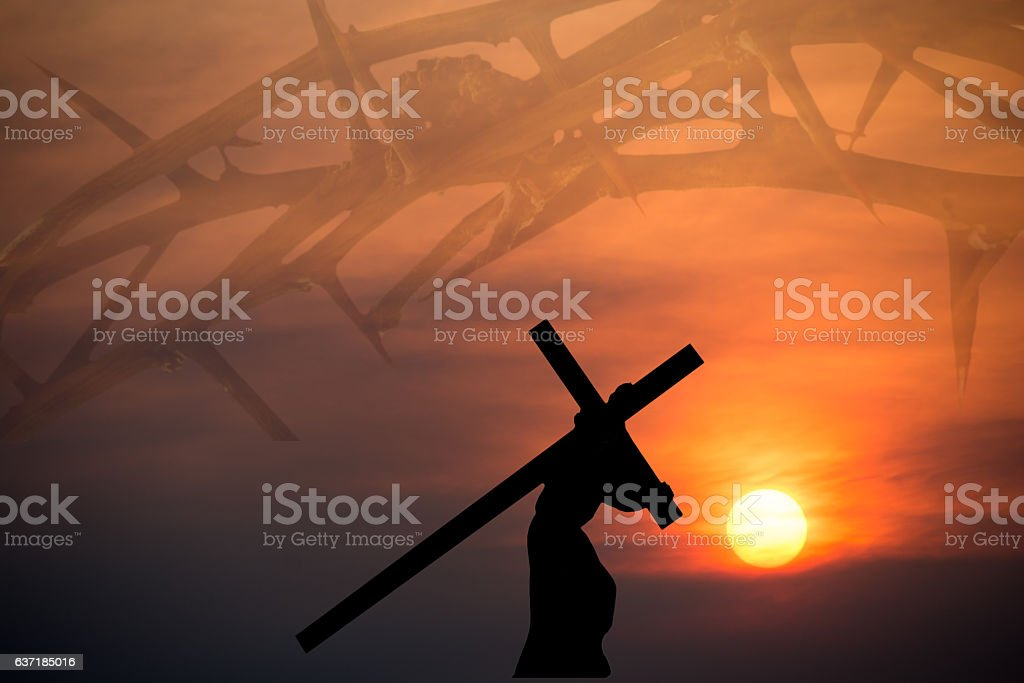 Christ carrying the cross with crown of thorns background stock photo